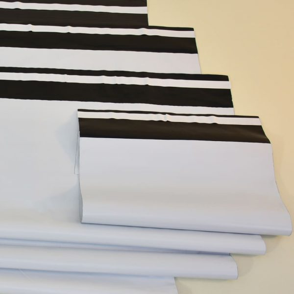Flap envelopes with adhesive tape