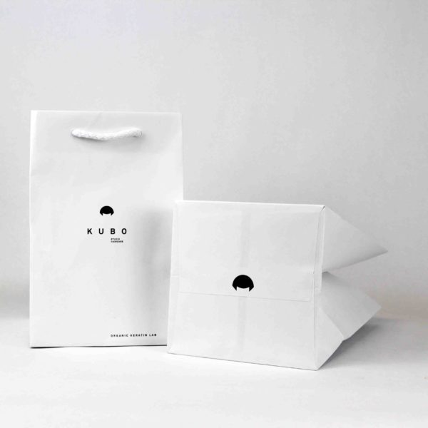 Paper bag with white cellulose rope handle