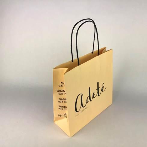 Bolsa de papel amarilla Adeté